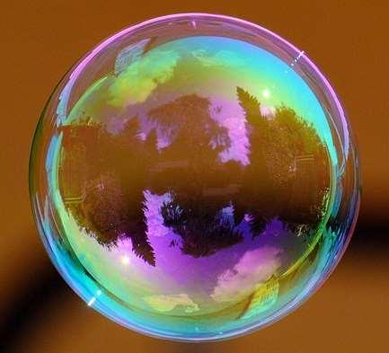 A soap bubble reflects light