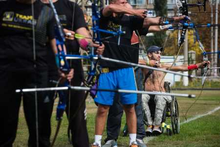 A wheelchair bound archer training for the Invictus games.